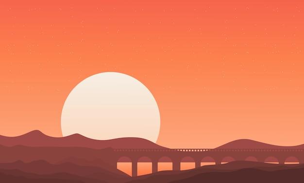 Silhouet van brug op montainachtergronden