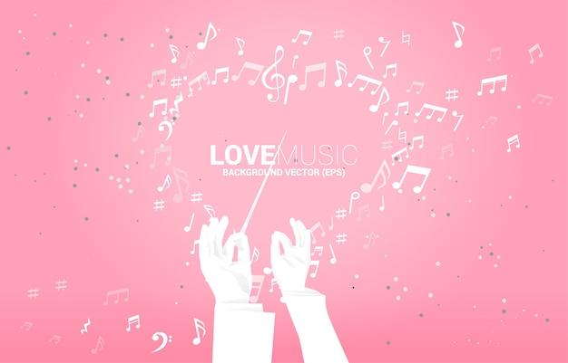 Silhouet van dirigent hand houden stokje stok met hart muziek nota vliegen.