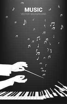 Silhouet van dirigent hand houden stokje stok met vliegende muzieknoot. concept achtergrond voor orkestconcert en recreatie.