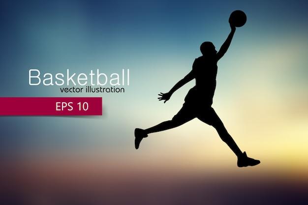 Silhouet van een basketbalspeler
