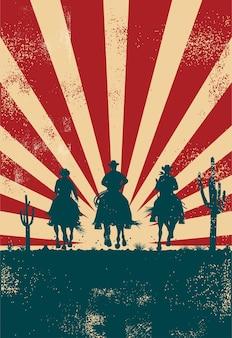 Silhouet van een cowboys die paarden berijden