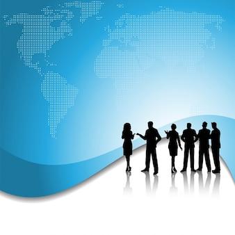 Silhouet van een groep van mensen uit het bedrijfsleven op de achtergrond van de wereldkaart