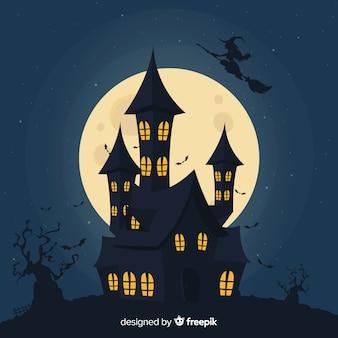 Silhouet van een huis op een volle maan nacht