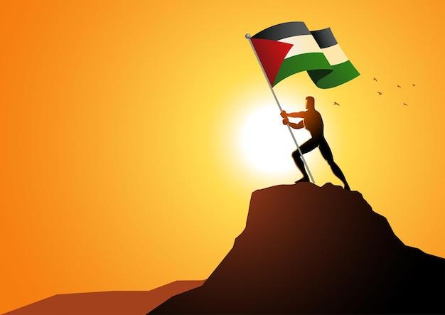 Silhouet van een man die de vlag van palestina op de top van een berg houdt