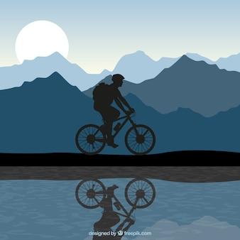 Silhouet van een man rijden op een fiets