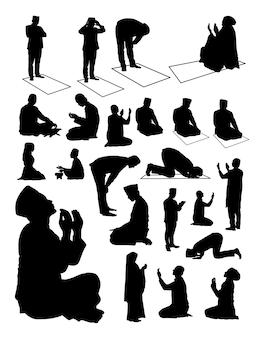 Silhouet van moslim bidden