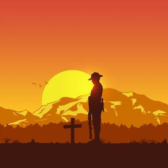 Silhouet van soldaat respect betuigen bij het graf,
