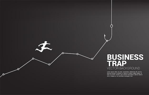 Silhouet van zakenman die hogere online grafiek met visserijhaak springen. concept aas en haak in zaken.