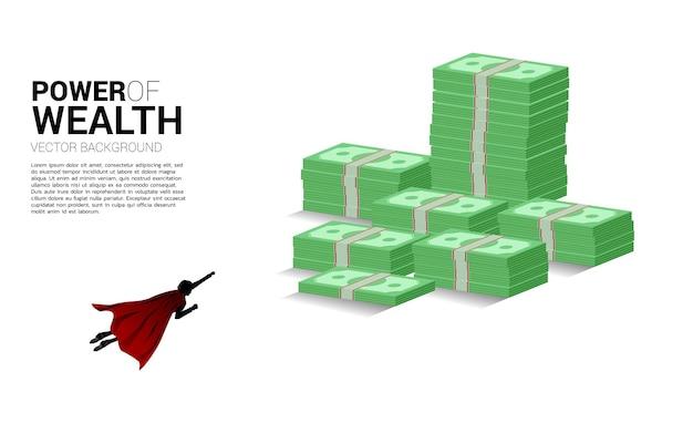 Silhouet van zakenman die naar de top van de stapel bankbiljetten vliegt. concept van succesinvesteringen en groei in het bedrijfsleven