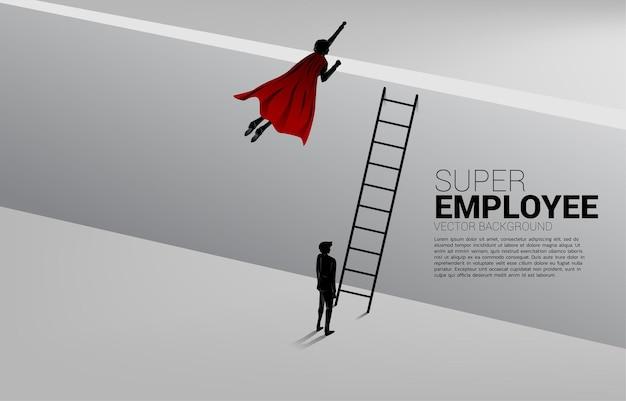 Silhouet van zakenman die over de muur vliegt. concept van boost en groei in het bedrijfsleven.