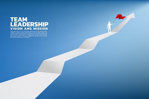 Silhouet van zakenman met de rode vlag die zich op de bovenkant van grafiek bevindt.