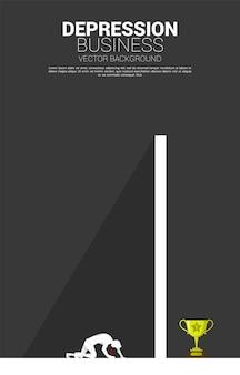Silhouet van zakenman op de knie voor de grote muur. concept voor depressie en obstakels.