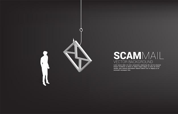 Silhouet van zakenman permanent met vishaak met e-mailpictogram. concept van zwendelmail en phishing.