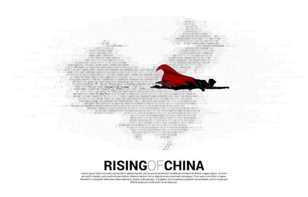 Silhouet van zakenman vliegen met china kaart van binaire nul en één code. concept voor china digitale valuta economie en financiële netwerkverbinding.