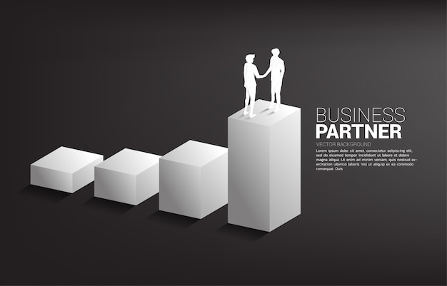 Silhouet van zakenmanhanddruk bij het kweken van grafiek. concept van teamwork partnerschap en samenwerking.