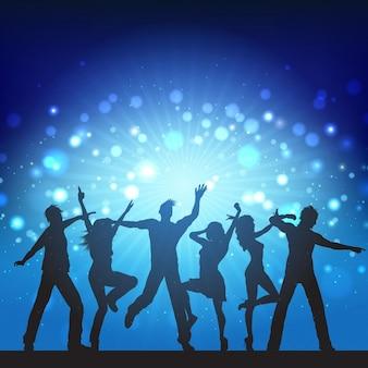 Silhouetten van de partij mensen op disco achtergrond verlichting