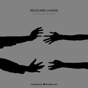 Silhouetten van handen te bereiken