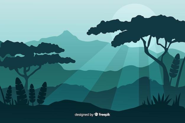 Silhouetten van tropische bosbomen bij zonsondergang