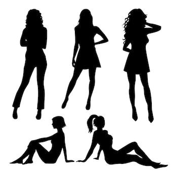 Silhouetten van vrouwen die bevinden zich en zitten