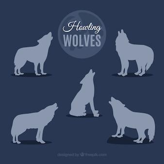 Silhouetten van wolven huilen