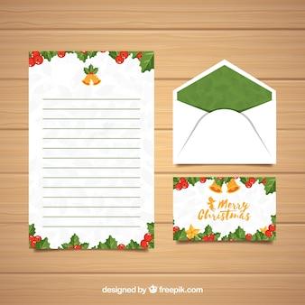 Sjablonen van een brief en een envelop voor kerstmis met groene elementen