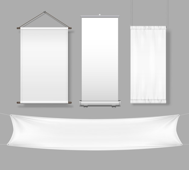Sjabloon van witte lege doek en papieren banners en bord met oprolbare display en beursstand geïsoleerd op een grijze achtergrond.