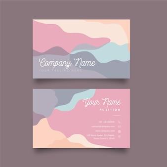 Sjabloon visitekaartje met pastel gekleurde vlekken