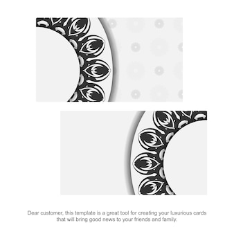 Sjabloon voor afdrukontwerp van visitekaartjes witte kleuren met mandala's. een visitekaartje voorbereiden met een plaats voor uw tekst en zwarte ornamenten.