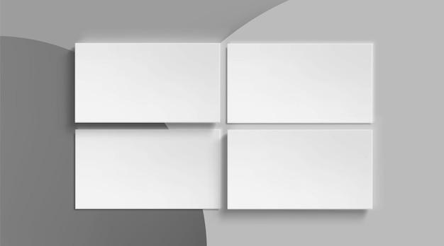Sjabloon voor blanco visitekaartjes op grijs