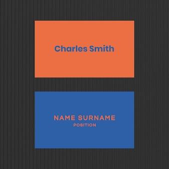 Sjabloon voor visitekaartjes in oranje en blauwe toon flatlay
