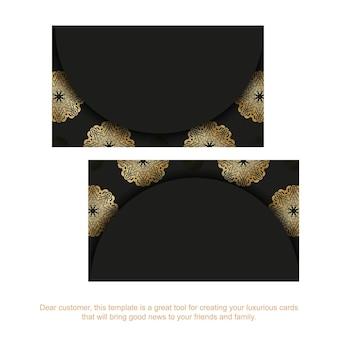 Sjabloon voor zwarte visitekaartjes met gouden mandala-ornament