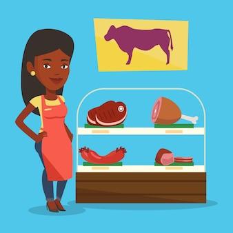 Slager die vers vlees in slagerij aanbiedt.