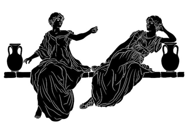 Slanke meisjeszusters zitten op een stenen borstwering