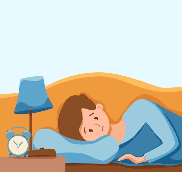 Slaperig wakker man in bed lijdt aan slapeloosheid