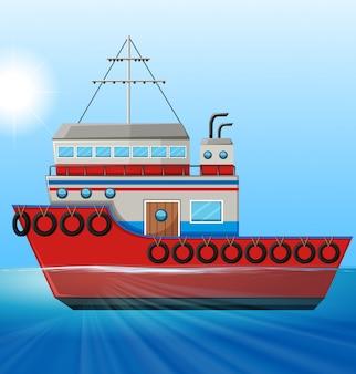 Sleepboot die in de oceaan drijft