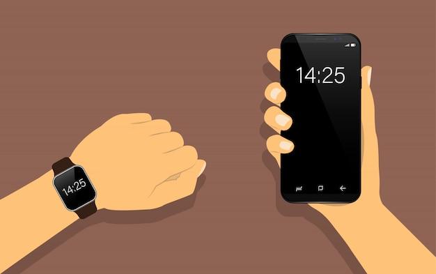 Slim horloge bij de hand en smartphone in de hand.