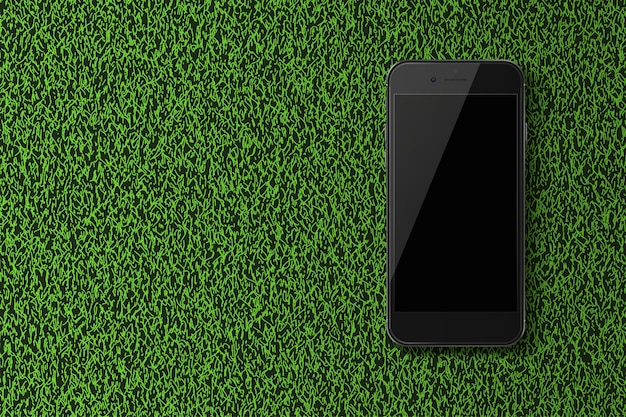 Slimme telefoon met zwart scherm op groen gras achtergrond.