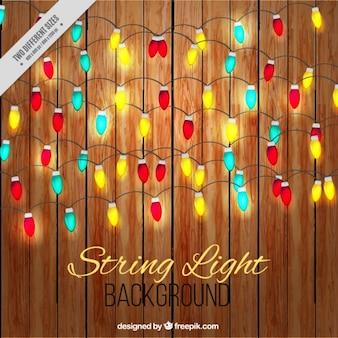 Slinger van gekleurde lichten op houten achtergrond