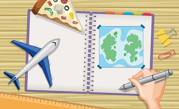Sluit omhoog hand het schrijven van plan voor reis op notitieboekje met vliegtuigmodel op bureauachtergrond