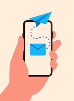 Smartphone in de hand met outbox e-mail en vliegende papieren vliegtuig vlakke stijl