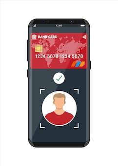 Smartphone met betaalapp met gezichtsherkenning en identificatie. biometrische identificatie gezicht id. draadloze contactloze of cashloze betalingen, rfid nfc