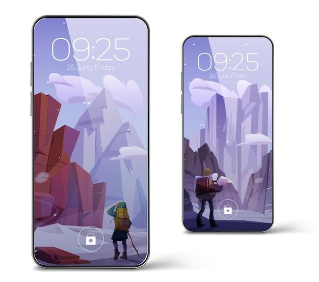 Smartphone met screensaverbehang met winterberglandschap en wandelaar