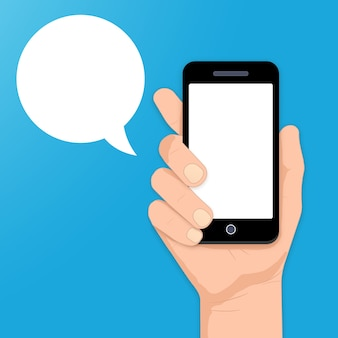 Smartphone met tekstballon in hand vectorillustratie Gratis Vector