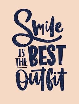 Smile is the best outfit-inscriptie geschreven met cursief kalligrafisch lettertype.