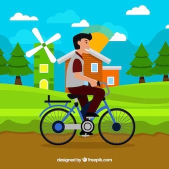 Smiley man op de fiets met schattig landschap