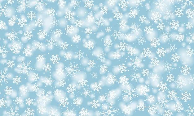 Sneeuw achtergrond. winterse sneeuwval. witte sneeuwvlokken op blauwe hemel. kerstmis achtergrond. vallende sneeuw.