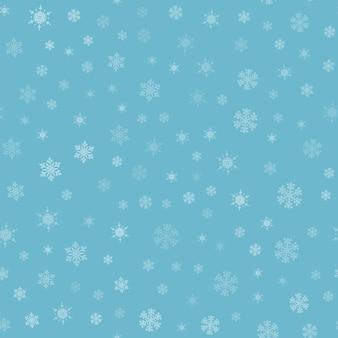 Sneeuw naadloze patroon. witte sneeuwvlokken op blauwe achtergrond. vallende sneeuw.