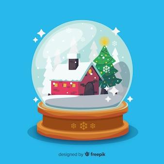 Sneeuwbalbol met kerstmisconcept in vlak ontwerp