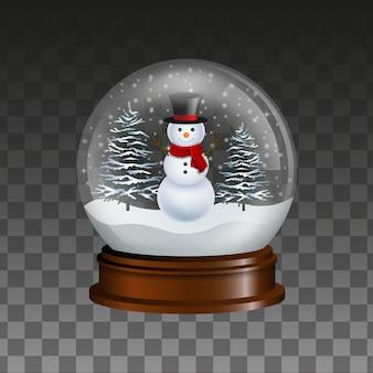 Sneeuwbol met sneeuwman en besneeuwde bomen