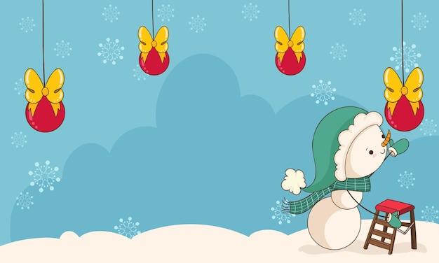 Sneeuwman plaatst de kerstversieringen
